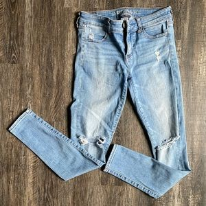 American Eagle - light blue jeggings - size 4 - holes in the knees